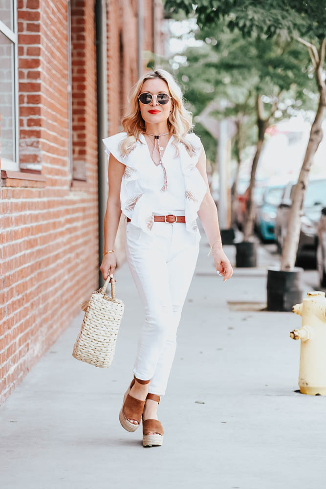 White jeans, white embroidered top featured by popular Los Angeles fashion blogger the hunter collector