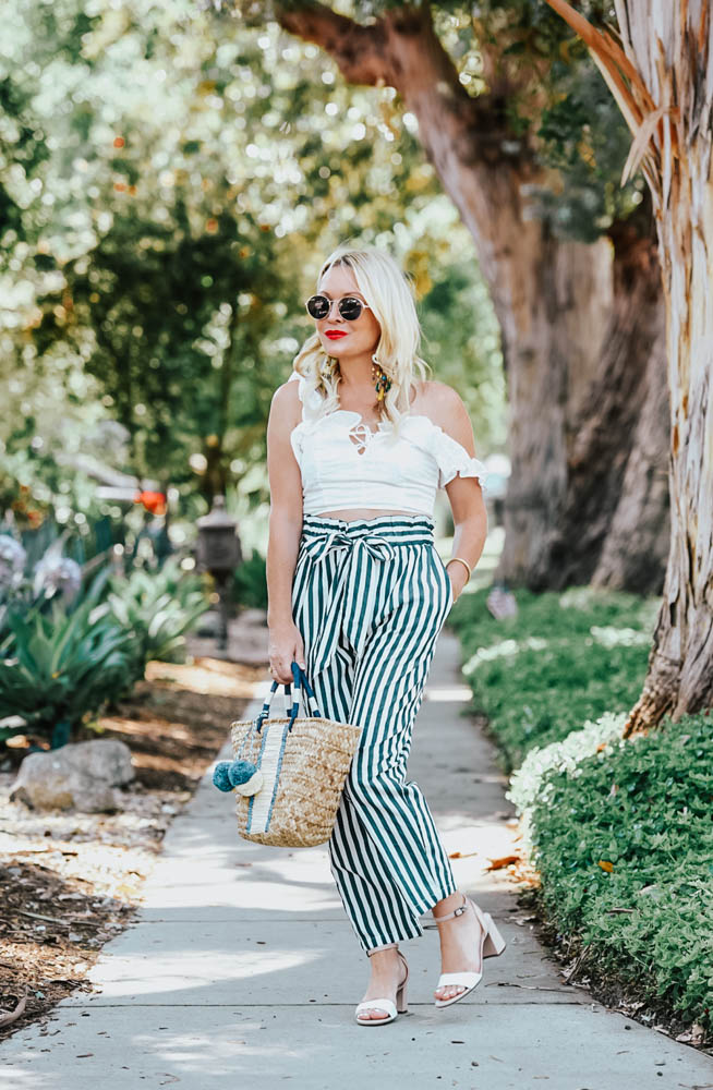 Zara Striped Pants, Eyelet Top, Straw Bag featured by popular Los Angeles fashion blogger The Hunter Collector