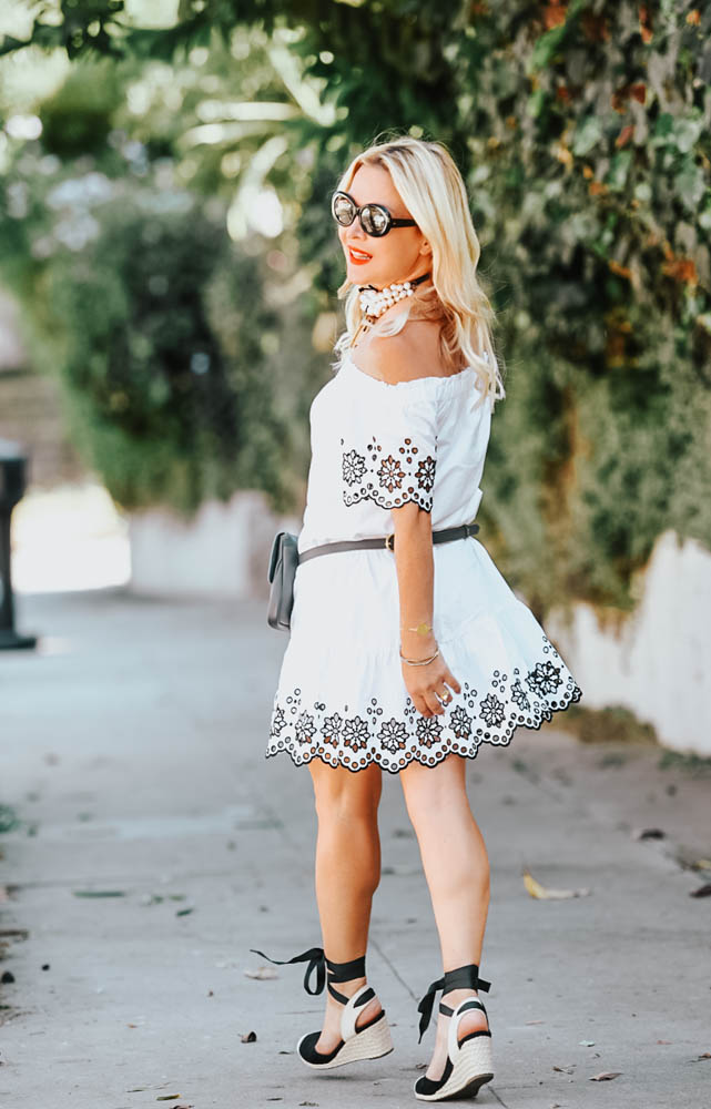 White Eyelet Dress, Belt Bag featured by popular Los Angeles fashion blogger The Hunter Collector