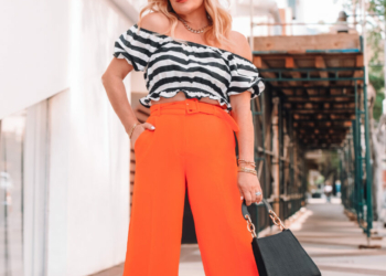 Cropped Orange Pants, B/W Top.